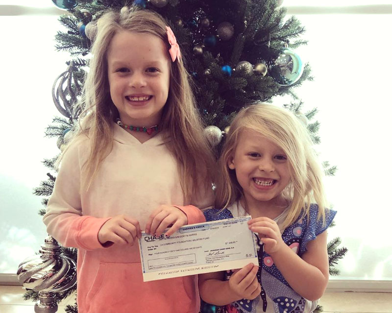 The Harris sisters who donated proceeds from their lemonade stand sales to wildfire relief.